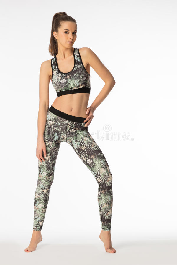 Women with muscular body wearing sport clothes. stock photos
