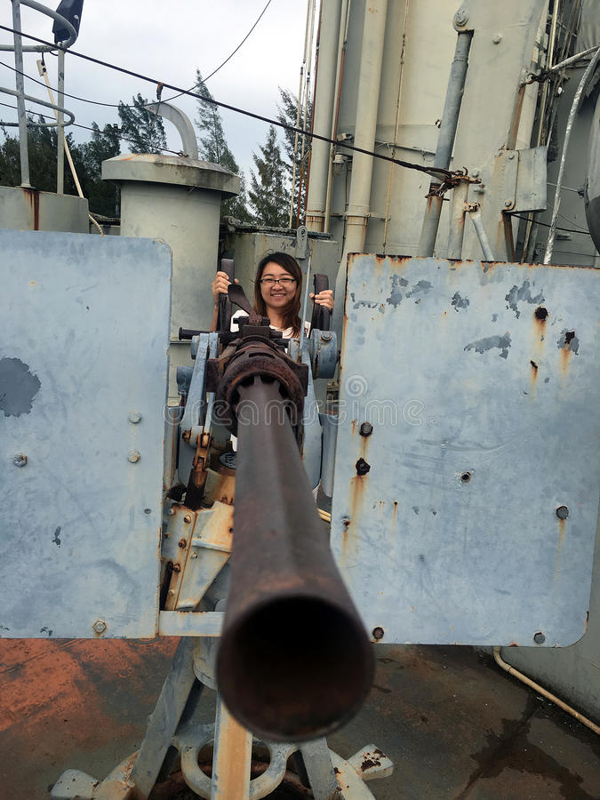 Women with Navy Battle Ship Gun stock image