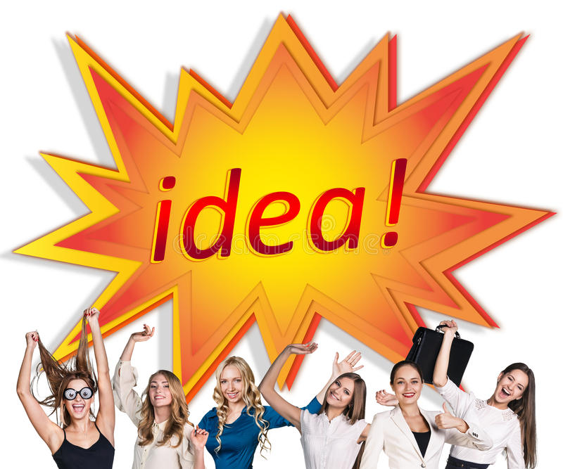 Women near image of comic book explosion. Young women near image of comic book explosion with idea word inside royalty free stock photo
