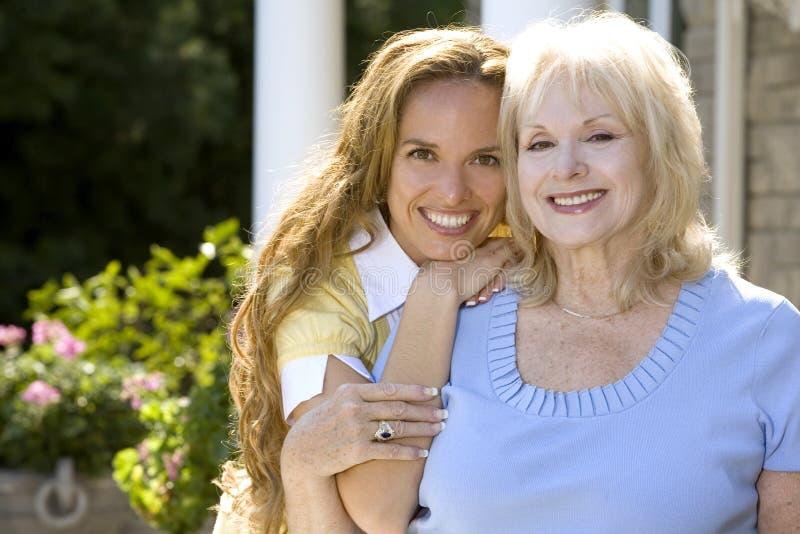 Women outdoors. Family mother and daughter outdoor summer having fun stock photos