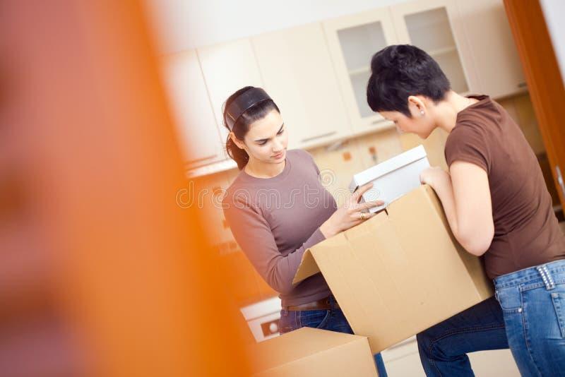 Download Women packing boxes stock image. Image of beautiful, caucasian - 9797537