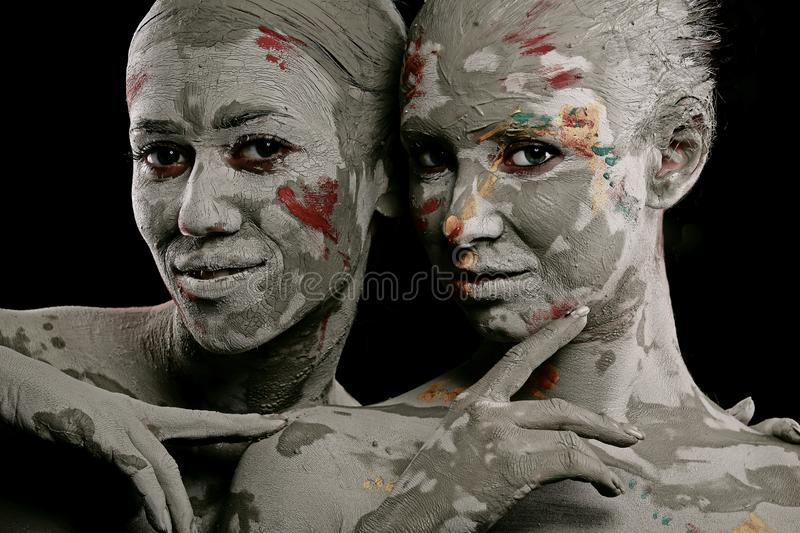Women painted with make-up stock photography