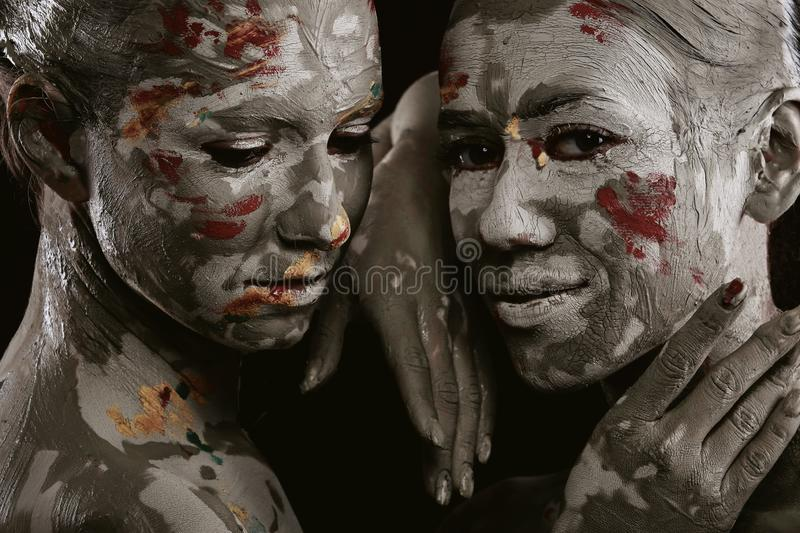 Women painted with make-up stock images