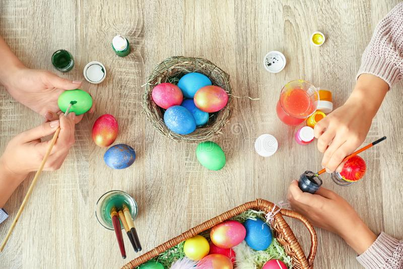 Women painting Easter eggs on table royalty free stock photography