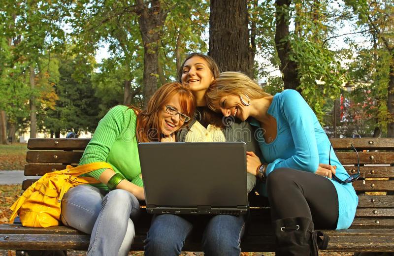 Download Women in park with laptop stock image. Image of smile - 11645727