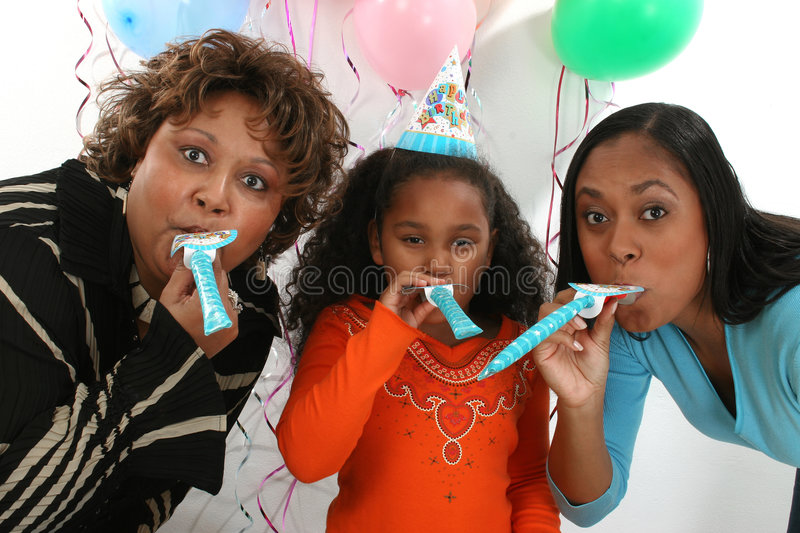 Women at party. Three generations of women at a birthday party stock image
