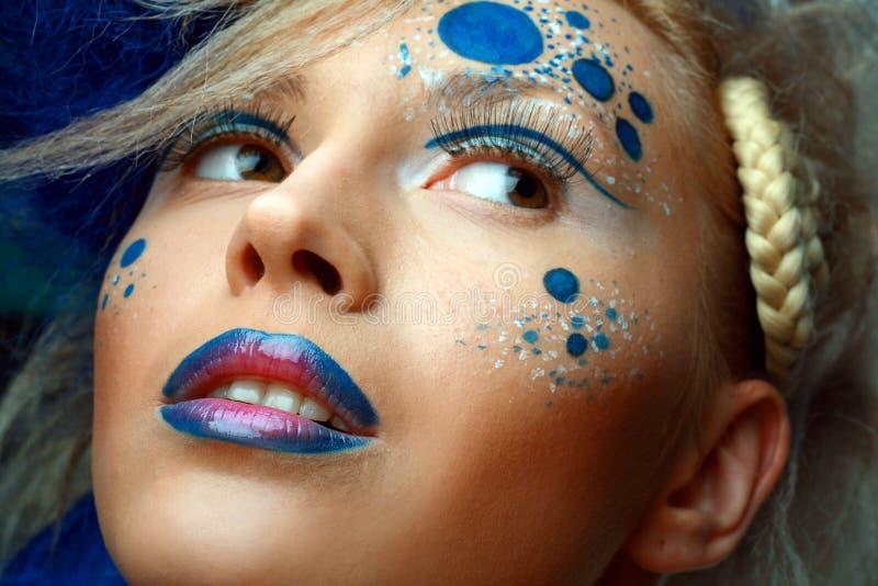 Women with perfect art make up. Gorgeous Young model beautiful women with perfect art make up and long false eyelashes. Focuse on lips stock photo