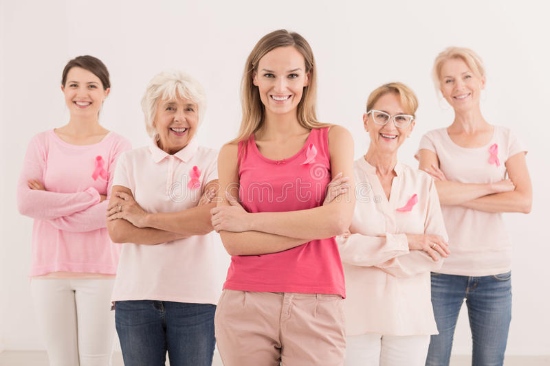 Women with pink ribbons royalty free stock photography