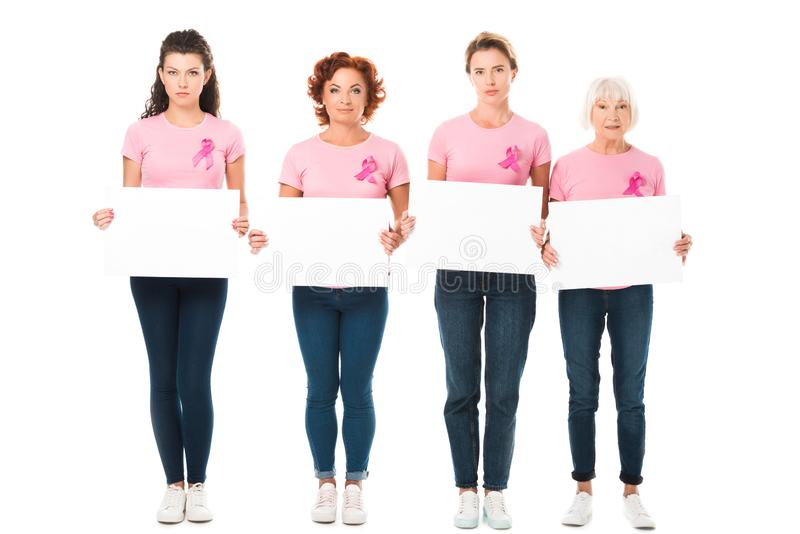 women in pink t-shirts with breast cancer awareness ribbons holding blank banners and looking at camera royalty free stock photo