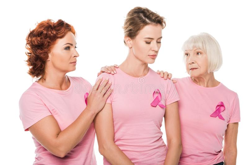 women in pink t-shirts supporting upset woman royalty free stock images