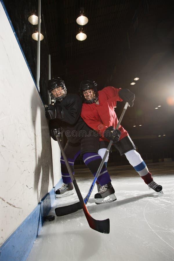 Women playing hockey. stock photos
