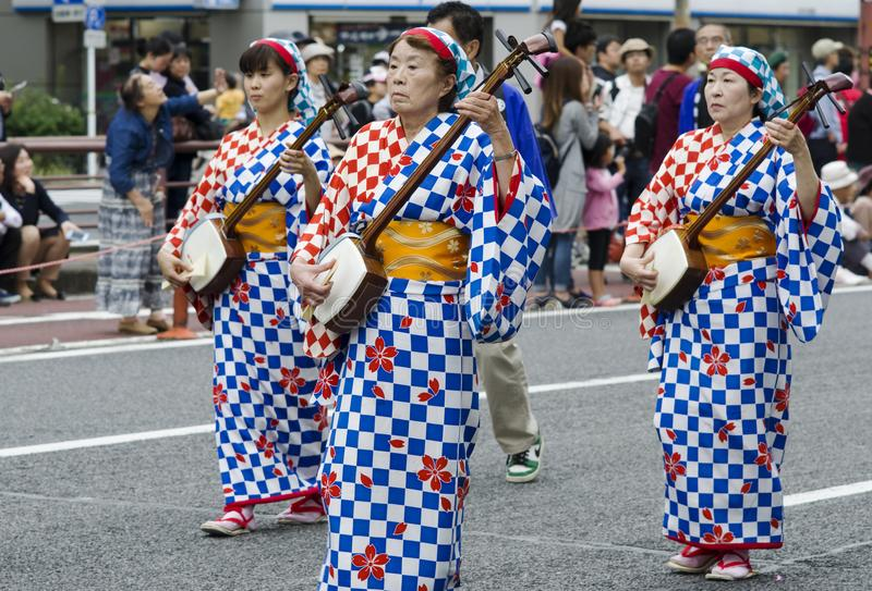 Women playing on shamisen. Women in regional kimonos playing on traditional Japanese musical instrument - Shamisen - during street performace at 62nd Nagoya