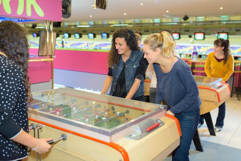 Women playing table football royalty free stock photos
