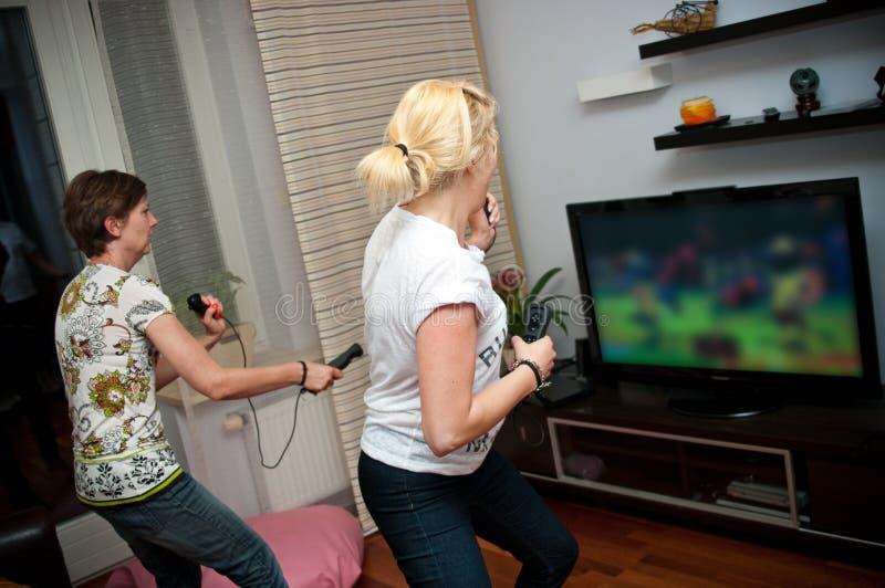 Women playing video game royalty free stock image