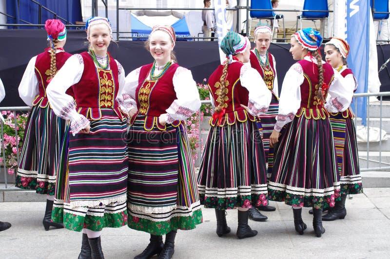 Women in Polish folk dance costumes stock image