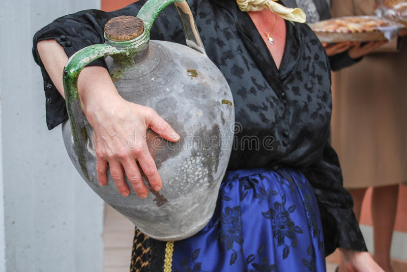 Women posing with ancient pot for water. An women posing with ancient pot for water stock images