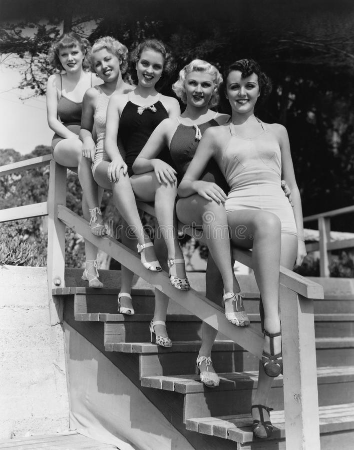 Women posing in bathing suits stock photo