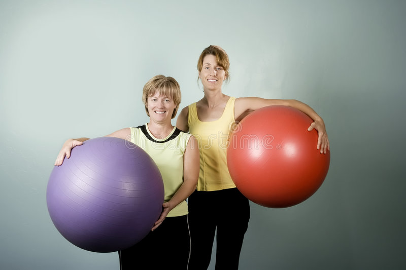 Women Posing With Exercise Balls stock image