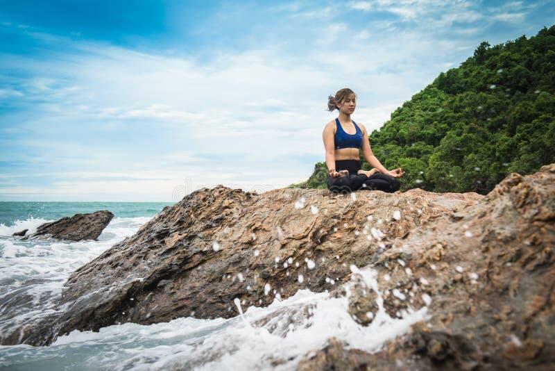 Women practicing yoga royalty free stock photo