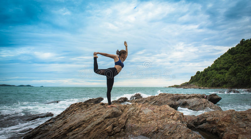 Women practicing yoga stock photography