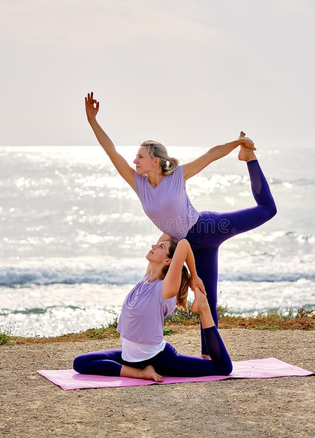 Women practising yoga do Natarajasana Lord of the Dance Pose outdoors stock photography