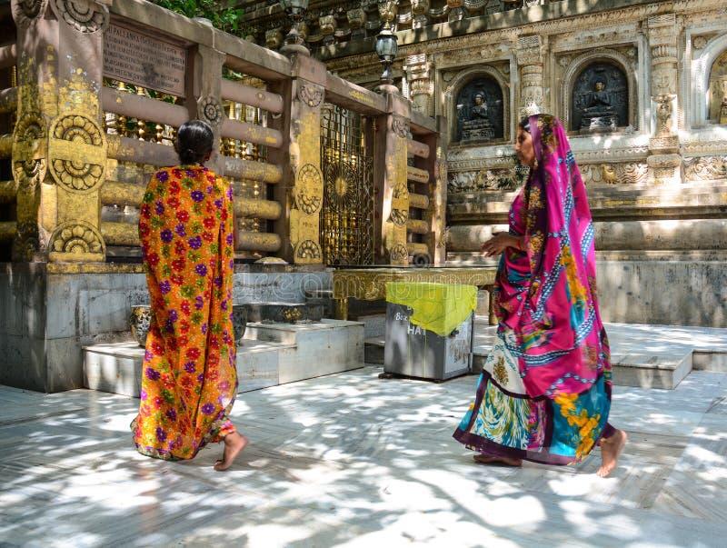 Women praying at the Buddhist temple in Gaya, India.  royalty free stock photo