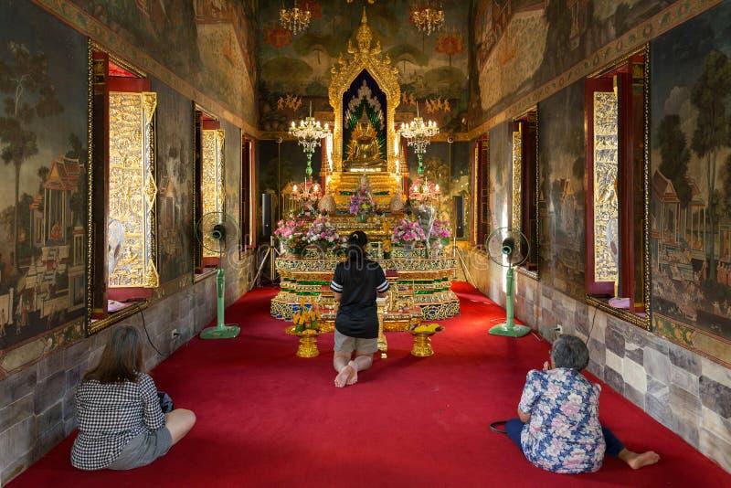 Women praying at buddhist temple. Women praying at the Wat pathum wanaram buddhist temple in Bangkok, Thailand stock image