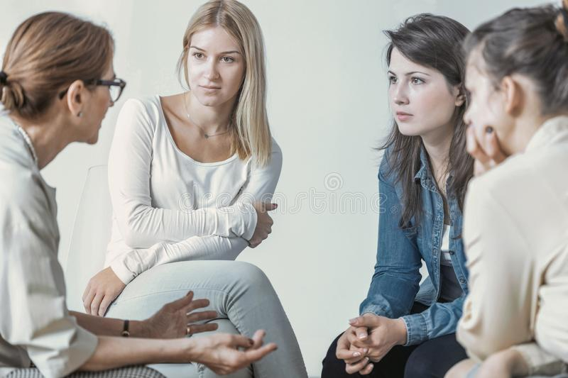 Women and psychologist talking about career during meeting. Concept royalty free stock image