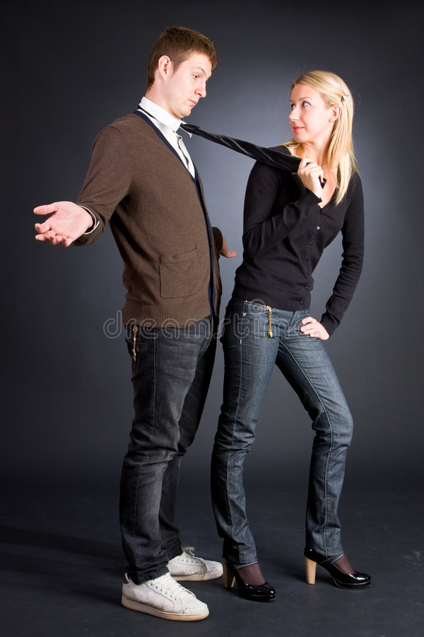 Download Women Pulling A Men By A Necktie Stock Image - Image: 6596439