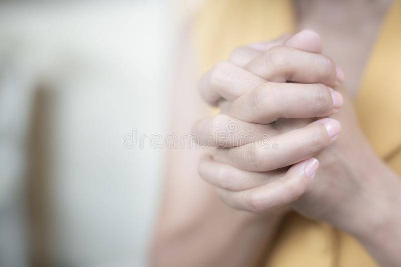 Women are raising their hands to pay respect and to calm their minds. Concept believe stock photos