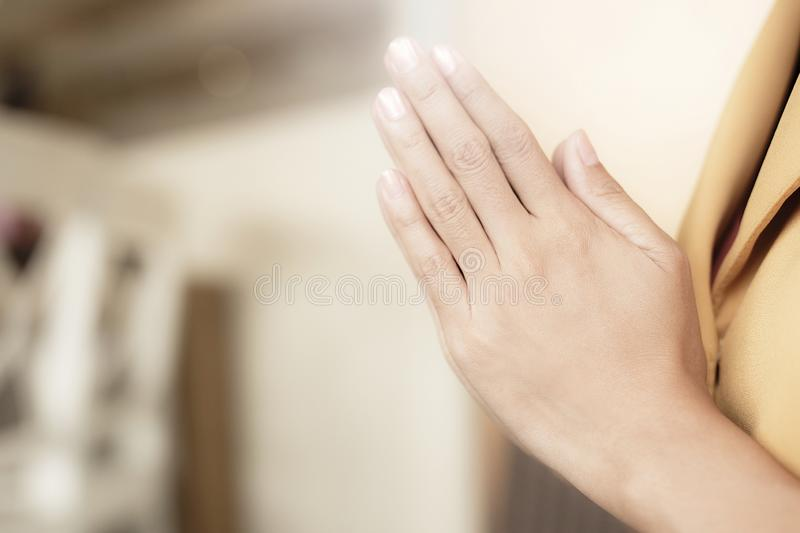 Women are raising their hands to pay respect and to calm their minds. Concept believe stock photo