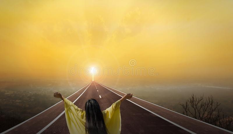 Women rare view on long paveway road with crucifix or cross stock image