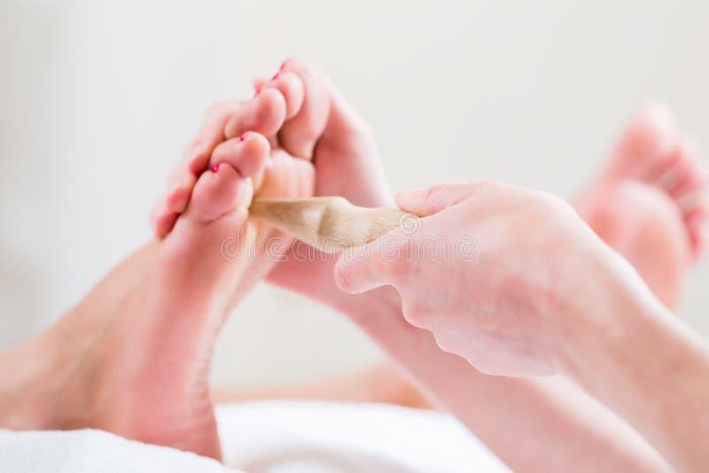 Women at reflexology having foot massaged royalty free stock photos