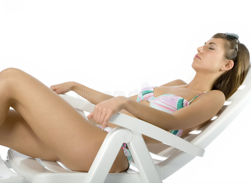 Women in relax. Woman relaxing on a deck chair stock photo
