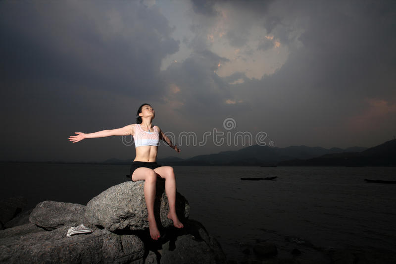 Women relax on rock stock photography