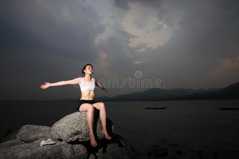 Women relax on rock royalty free stock photography