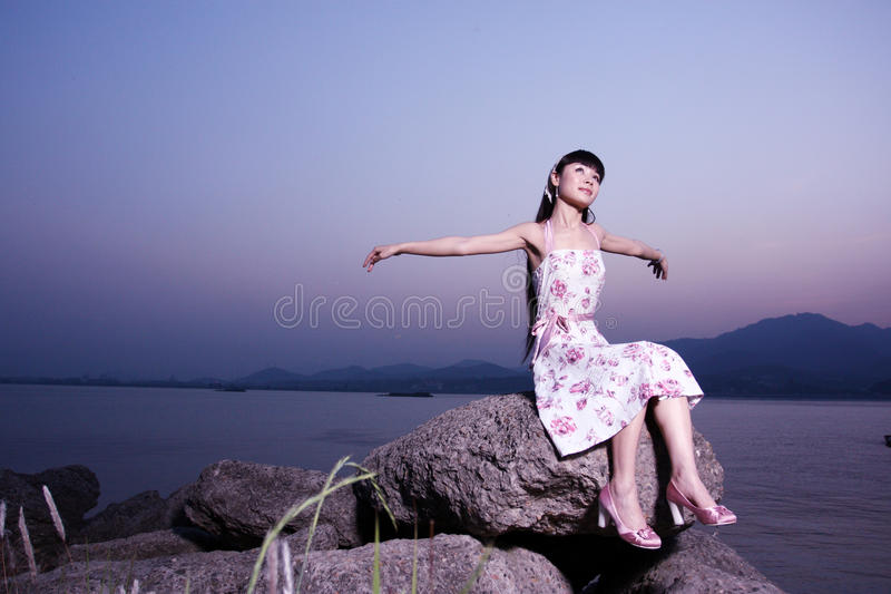Women relax on rock royalty free stock image