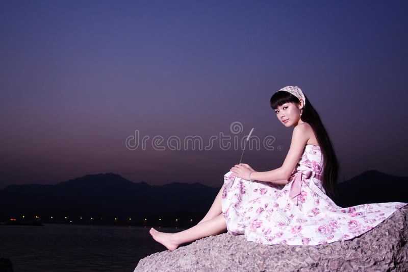 Women relax on rock royalty free stock photo