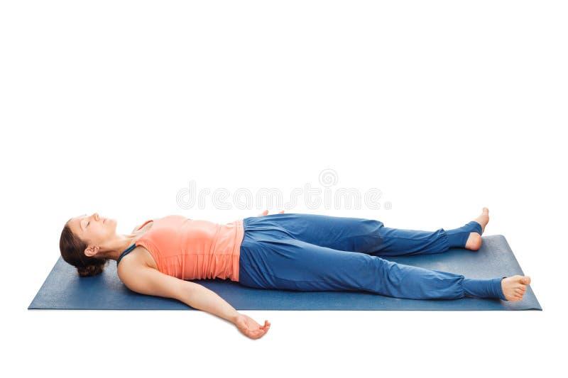 Women relaxes in yoga asana Savasana royalty free stock images