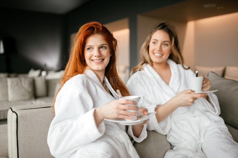 Women relaxing and drinking tea stock photo