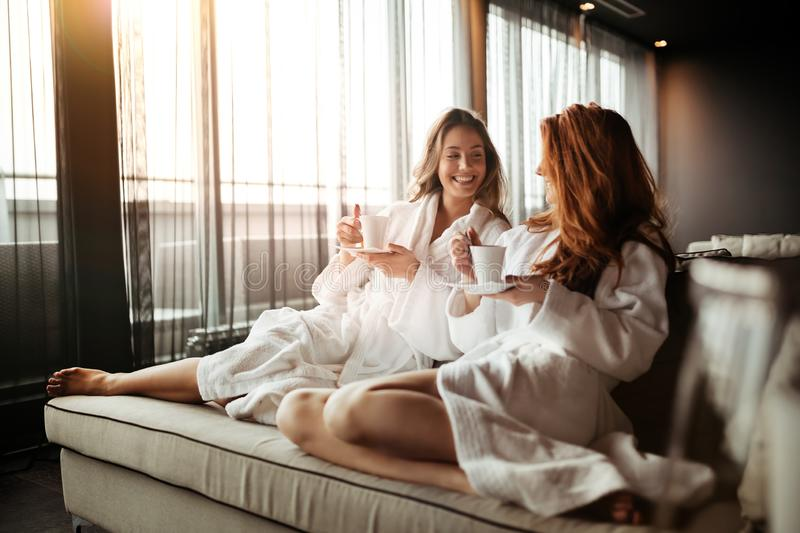 Women relaxing and drinking tea royalty free stock images