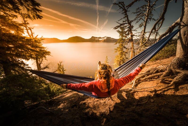 Women Relaxing in Hammock Crater Lake Oregon. Woman Hiker Relaxing in Hammock Crater Lake National Park Oregon stock image