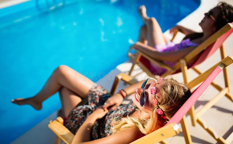Women relaxing and sunbathing royalty free stock images