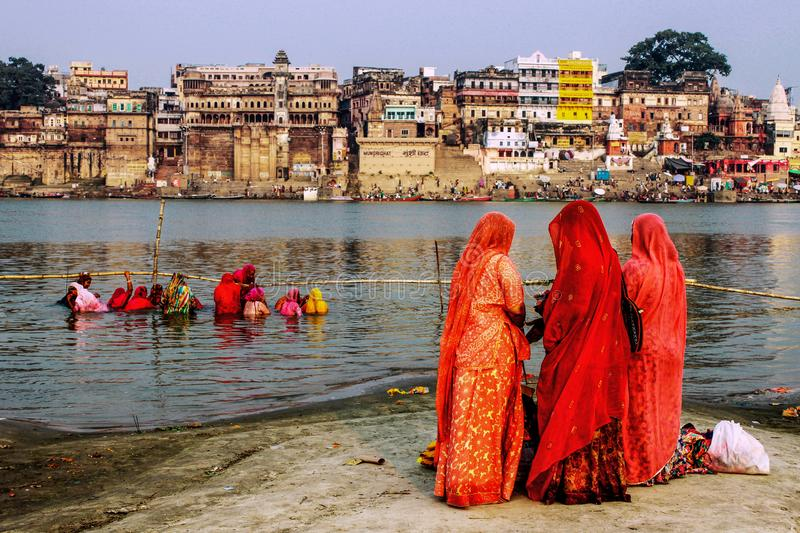 Women and religious rituals in the Ganges stock photo