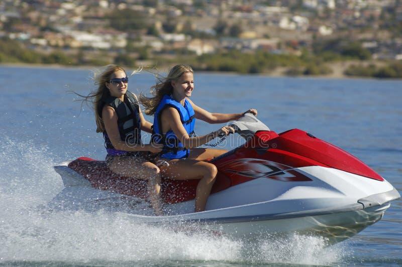 Women Riding PWC royalty free stock images