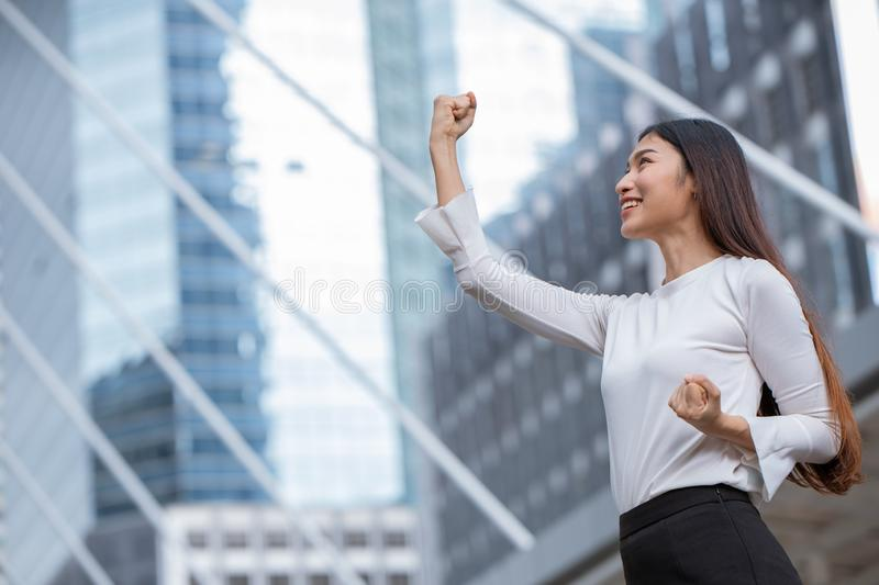 Women rise her hand for business winner success royalty free stock photo