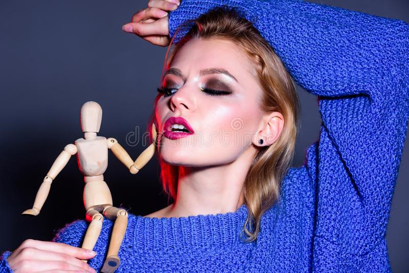 Women rule the world. sexy woman with fashion makeup. wooden figure on shoulder of girl. natural beauty. artificial. Fashion. vogue concept. professional visage royalty free stock photos