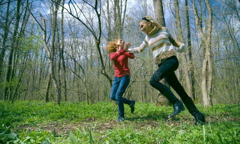 Women running in forest stock photo