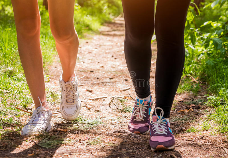 Women running in the forest stock photo