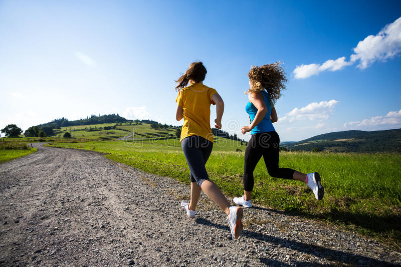 Women running, jumping outdoor stock images